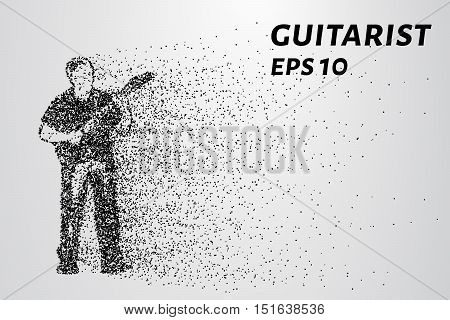 Guitarist from particles. The man playing the guitar. Vector illustration