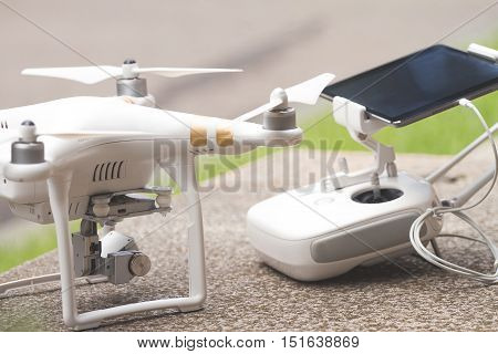 White Quadrocopter With Remote Control, Close-up. New Unmanned A