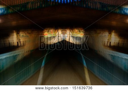 Subway tunnel with abstract motion blur POV of a driver skater pedestrian