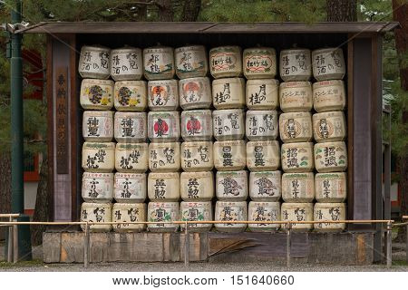 Kyoto Japan - September 15 2016: Wall of empty Sake barrels at Heian Shinto Shrine. They are called Kazaridaru. Brewers donate sake to the shrines for rituals. Such sake is called O-Miki.