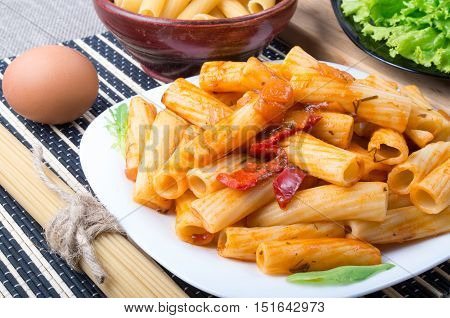 View Closeup On A Dish Of Rigatoni Pasta With Vegetable Sauce