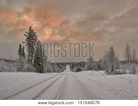 Scenic warm-Colorl Sunset over Finnish Road
