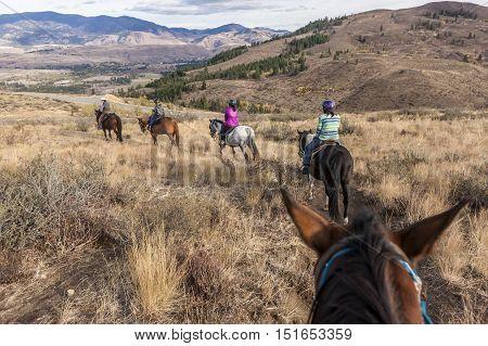 A family follows behind a guide on Sun Mountain near Winthrop Washington.