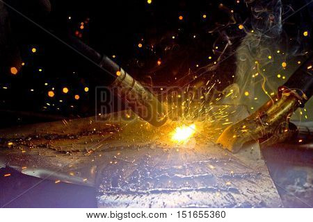 To Weld a iron sheet in Detail. Outdoor Shot.