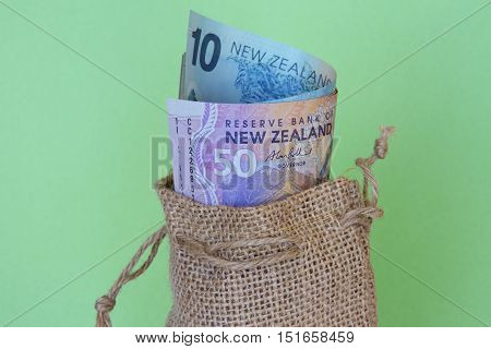 NZ dollars in a brown hessian bag.