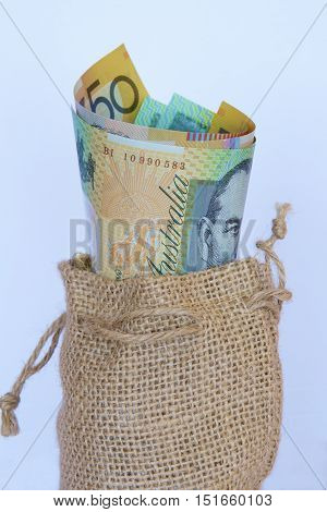 Some Australian dollar notes in a hessian bag.