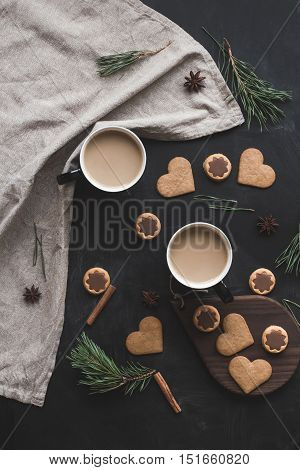 Christmas composition. Cup of coffee christmas gingerbread pine branch cinnamon sticks anise star. Flat lay top view