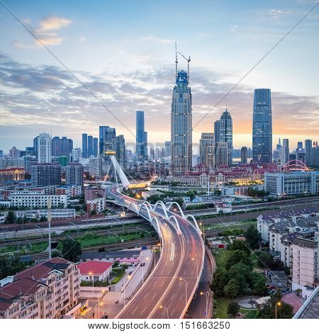 beautiful tianjin at dusk modern cityscape of road bridge and business district China