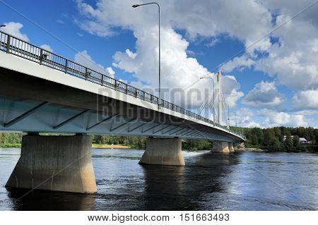 ROVANIEMI FINLAND - August 082016: The Jatkankynttila bridge (Lumberjack Candle Bridge) over Kemijoki river