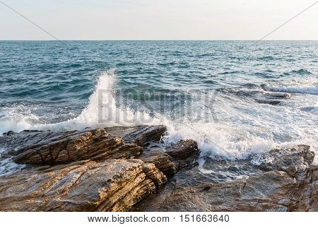 water of thailand sea crushes in rocks of the koh samet island's shore.