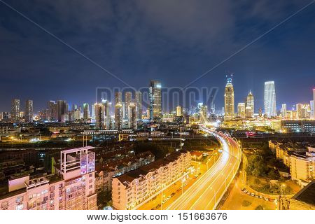 tianjin night view of skyline and city roads with business district China