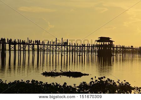 The beautiful silhouette longest wooden bridge in  Myanmar.