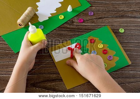The Child Create Christmas Greeting Cards Paper Festive Fir. Child Glue The Paper Details. Children'