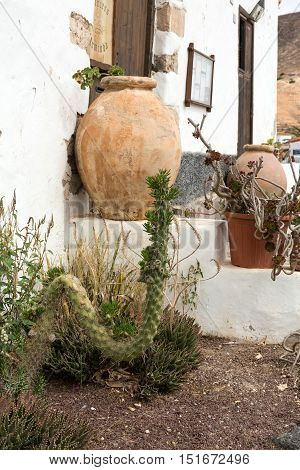 FUERTEVENTURA, SPAIN - SEPTEMBER 16, 2015: Clay-bowls at stairs of the house in Betancuria on Fuerteventura. Canary Island Spain
