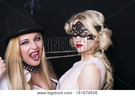 Two young beautiful women with dreads and collar playing in slave