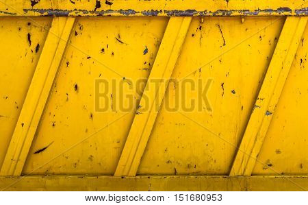 Side details of a yellow rubble container. Ideas for grunge background.