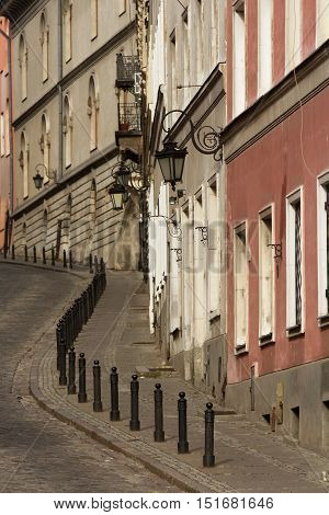 paved with stones climbing the arch uphill street in Warsaw Mariensztat