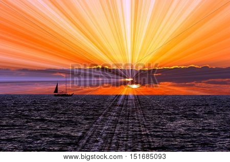 Sunset sailboat is a silhouetted boat sailing along the ocean water withe a sun burst of rays flowing out from behind the clolorful cloud filled sky.