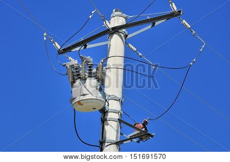 Close-up distribution transformer on concrete power pole