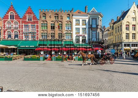 Bruges, Belgium - April 6, 2008: Tourists Ride On The Grote Markt