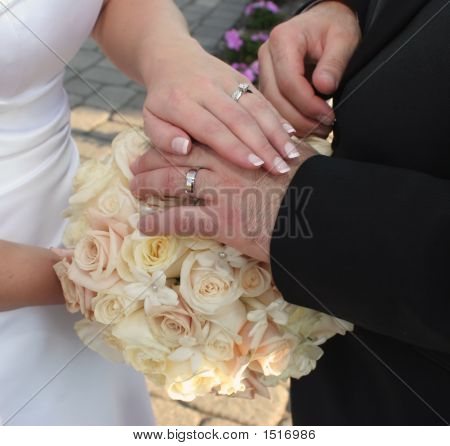 Hands, Rings And Flowers