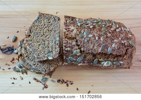 Sliced chrono organic unleavened bread with various seeds pumpkin sunflower flax seeds delicious and very healthy view from above