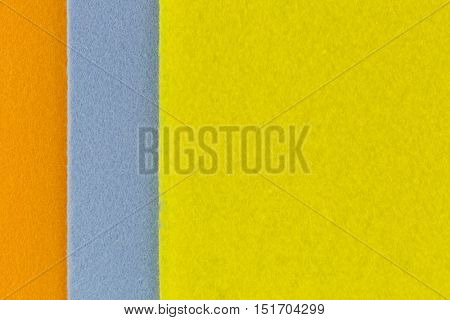 Closeup texture photo of super Absorbent fabrics in orange blue yellow color. Abstract background of absorbing cloth