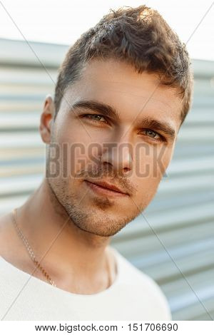 Close-up Portrait Of A Handsome Young Guy With A Beard In A Summer Day.