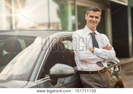 Businessman Posing With His Car
