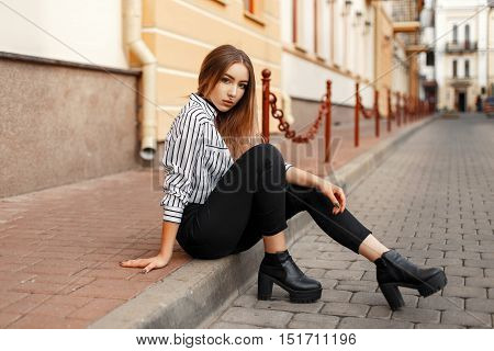 Pretty Hot Woman Sitting On The Curb.