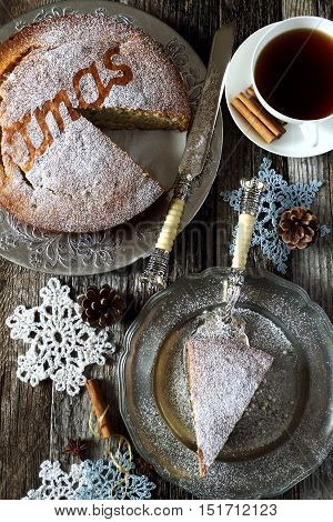 Homemade spiced Christmas sponge cake and crocheted snowflakes