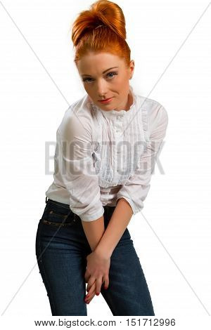 beautiful red-haired girl in a white blouse isolated on a white background