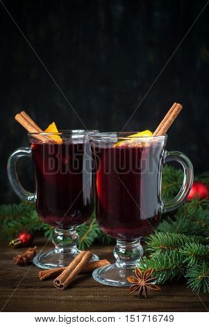 Christmas hot drink with decorations. Mulled wine in glasses.