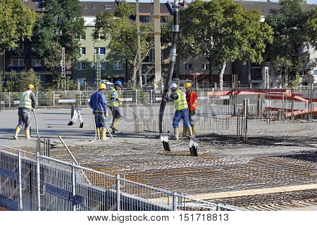 DÜSSELDORF GERMANY - OCTOBER 5: A Group of construction workers during the concreting of the ceiling slab in Düsseldorf Germany on October 5 2016