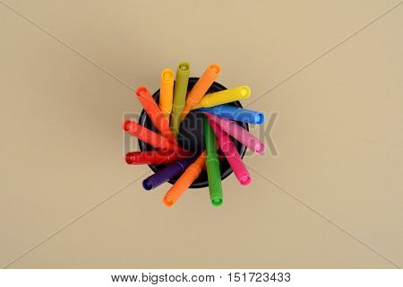 Set of Colorful markers top view in pen holder.