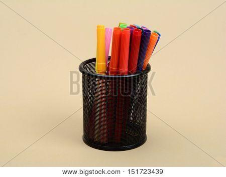 Set of Colorful Markers in Black Pen Holder.