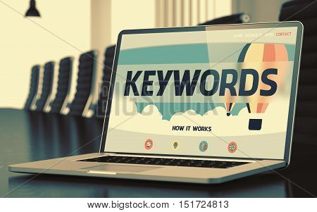 Mobile Computer Display with Keywords Concept on Landing Page. Closeup View. Modern Conference Room Background. Blurred Image. Selective focus. 3D Render.