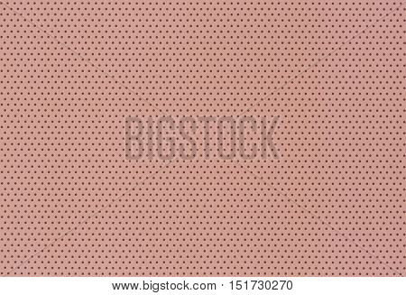 Brown polka dot background- small dots on paper