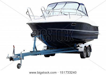 Modern boat loaded on a biaxial trailer.