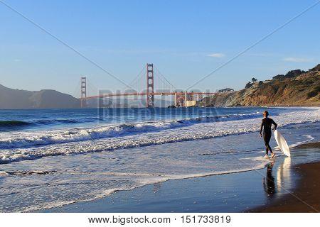 Surfer at Golden Gate Bridge San Francisco USA