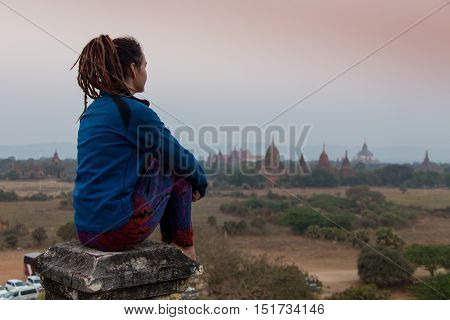 Young traveller enjoying a looking at sunset on Bagan, Myanmar Asia. Panoramic view.Traveling along Asia, active lifestyle concept.