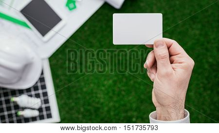 Contractor Holding A Business Card
