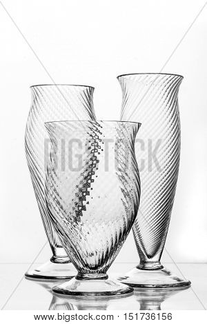 various types of crystal glasses over white background