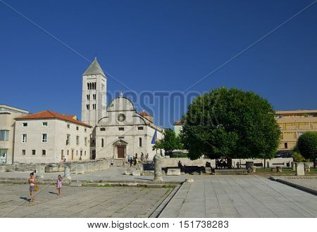 ZADAR CROATIA - JULY 12 2016: St. Donat church forum and Cathedral of St. Anastasia bell tower in Zadar Croatia. Zadar is famous tourist spot at Adriatic sea coast in Dalmatia.