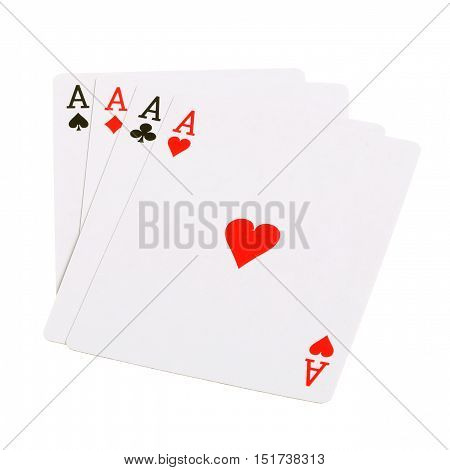 Four aces from a deck of cards with the ace of hearts on top isolated on white background.
