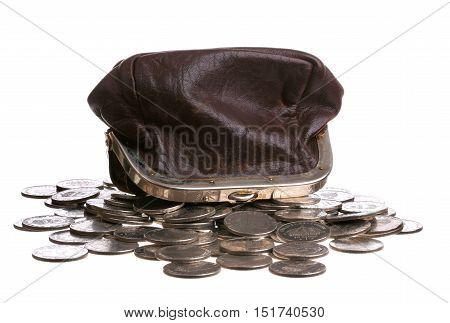 A brown purse upside down on top of a pile of Swedish coins isolated on white background.