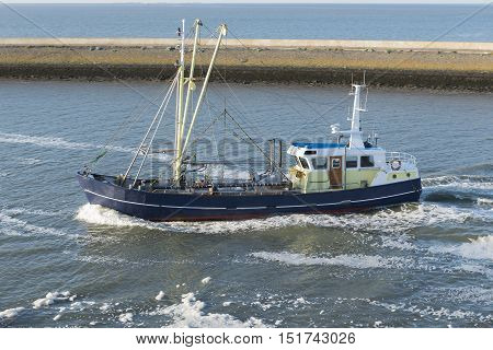 Fishing boat entering the fishing port of Harlingen from the UNESCO protected Wadden Sea in the Netherlands