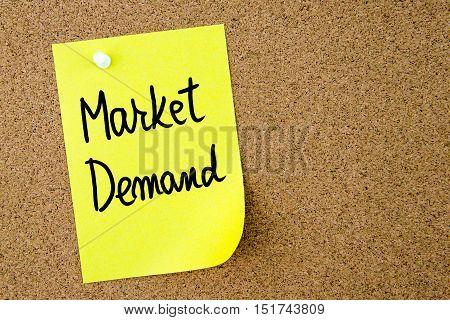 Market Demand Text Written On Yellow Paper Note