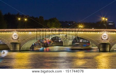 The pont Louis Philippe is a bridge across the river Seine in Paris. It is located in 4th arrondissement and links the quai de Bourbon on the Ile Saint Louis with the Saint Gervais neigborhood on the right bank.