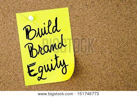 Build Brand Equity Text Written On Yellow Paper Note